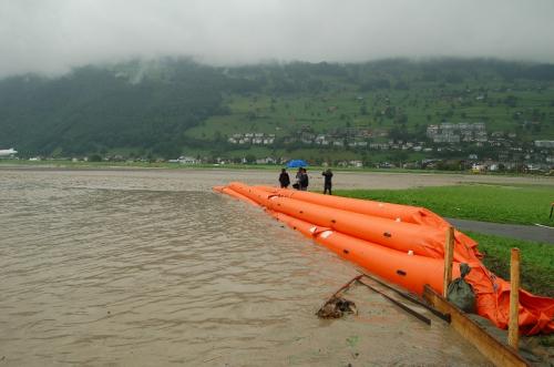 Triple tube flood barrier at riverine flood, flood protection.