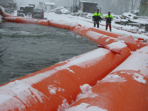 Swiss Army testing various barriers for flash flooding.