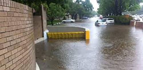 FloodBreak automatic self rising flood barrier for car park entrance.