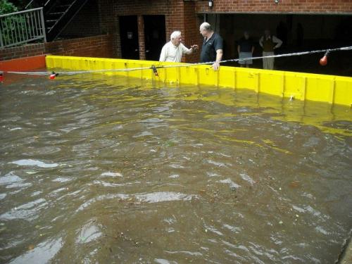 FloodBreak automatic self rising flood barrier on driveway.