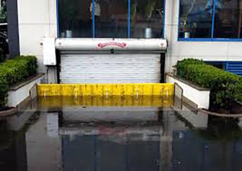FloodBreak automatic self rising flood barrier for underground garage.