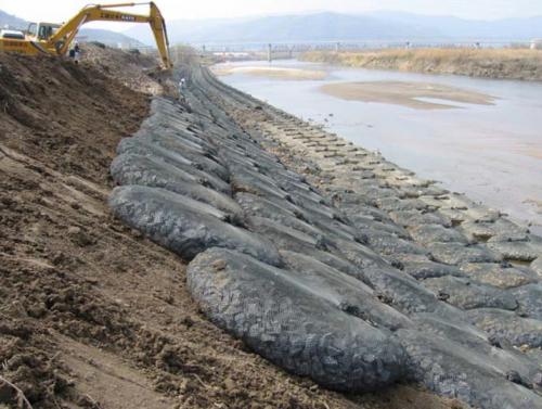 River embankment rock bag installation
