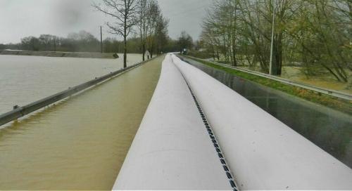 NoFloods flood barrier deployed on road
