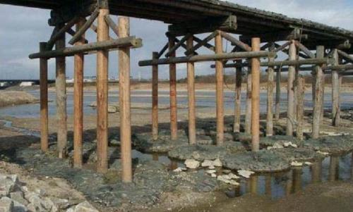 Rock bags to stop and prevent bridge erosion around pylons