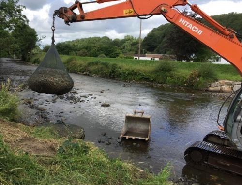 Rock bags deployed in waterway